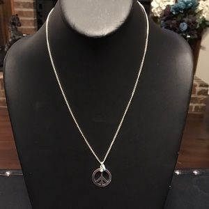 Silver tone peace sign charm necklace.  2/$10 Sale